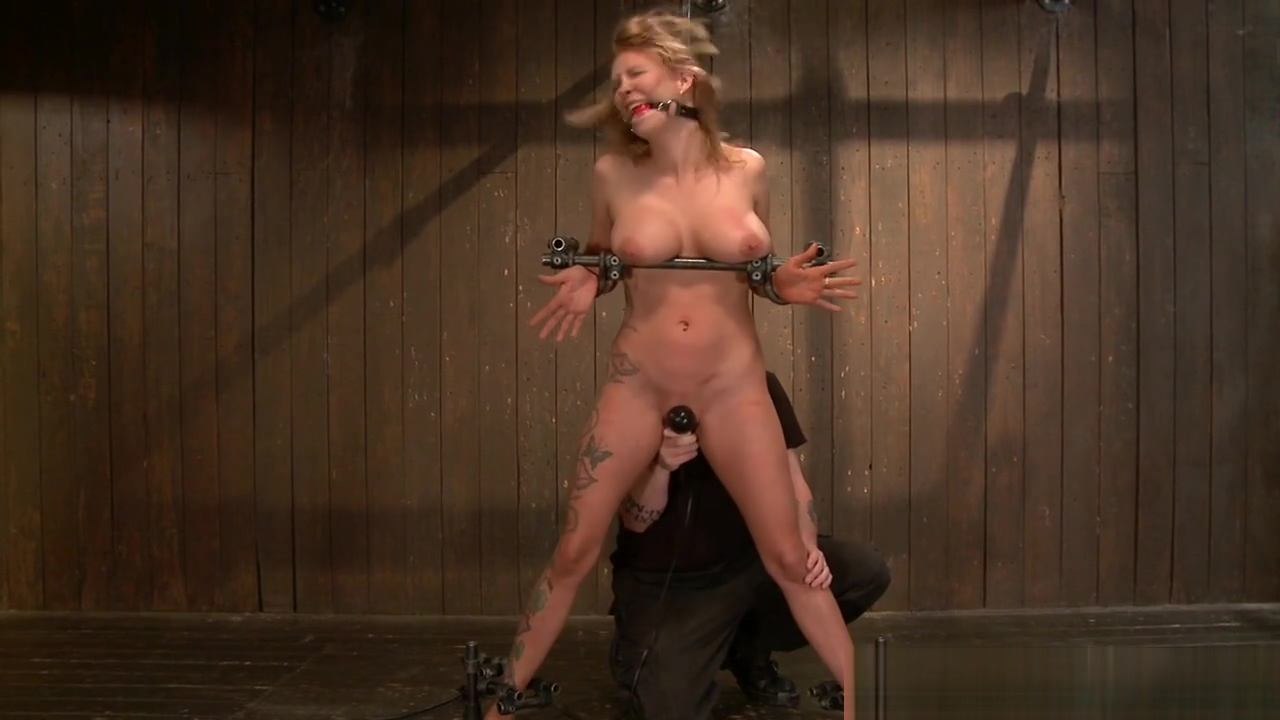 Huge tits blonde locked in rigid device