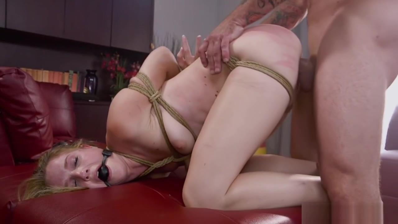 Brunette gets big cock in rope bondage