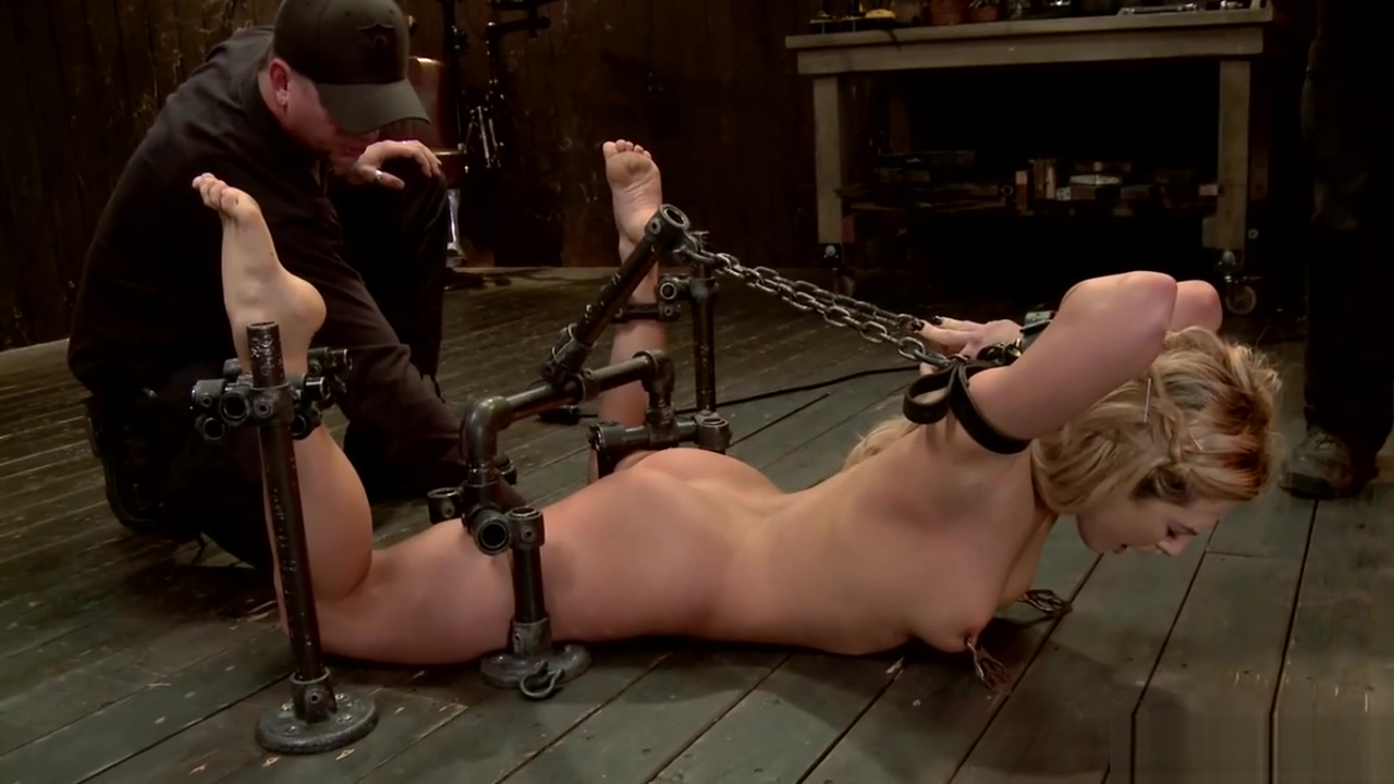 Chained blonde in back bend bondage