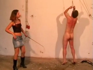 Sadistic young mistress whipping her slave