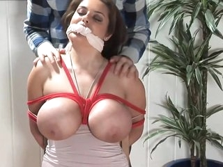 Busty Bimbo In Bondage