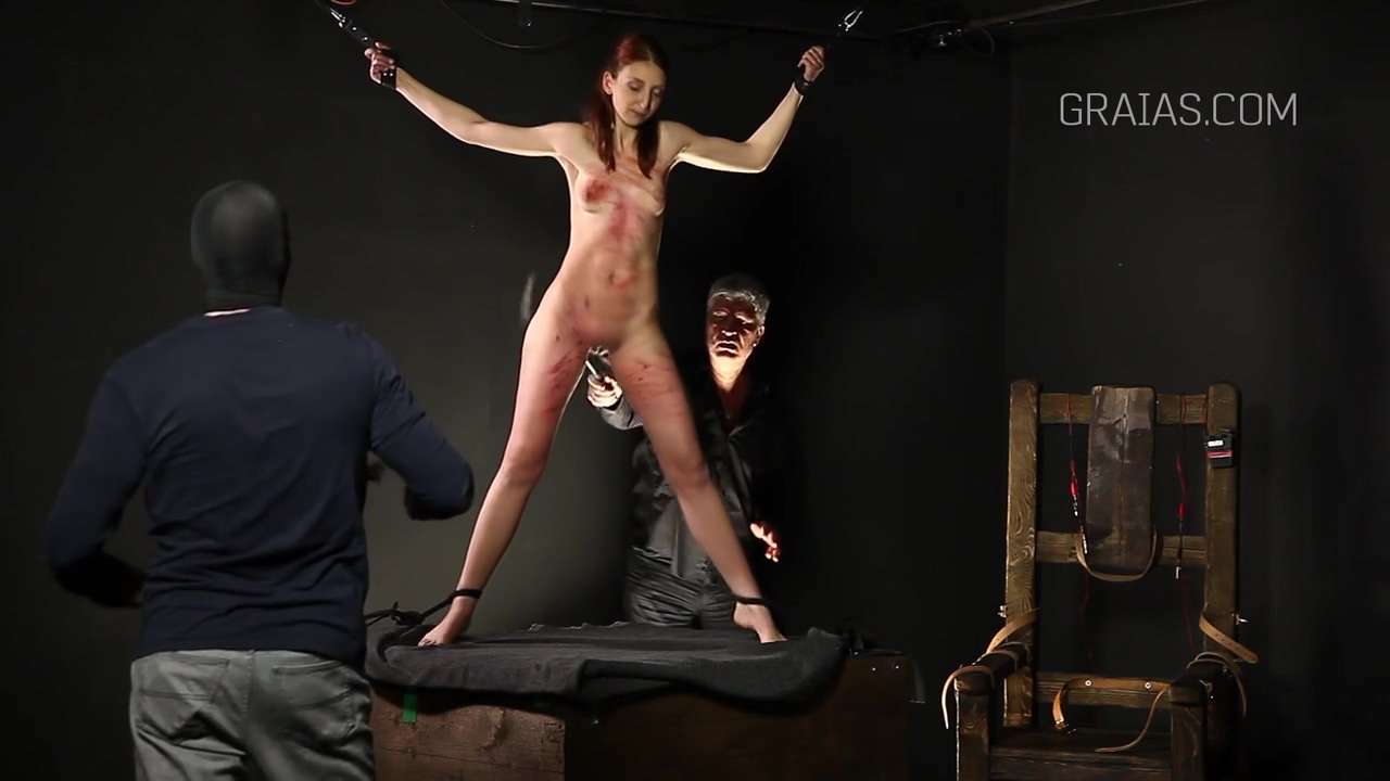 Slim lady is into BDSM and likes to get whipped very hard, while tied up tight