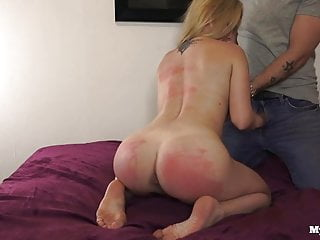 Young blonde sucks dick and is spanked with belt and crop