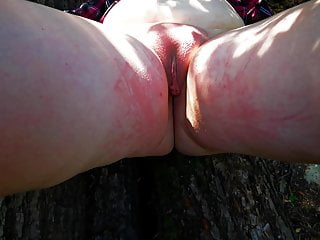 Ass and labia, hard whipping in the woods
