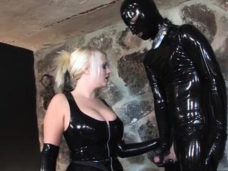 Busty mistress receives a nice footlick