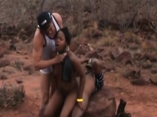 2 African babes get spanked and whipped by 2 dudes outdoor