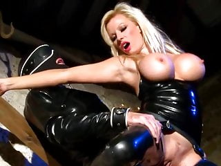 Smoking hot MILF in latex, fucked by slave.