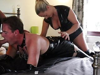 Latex Slutty Guy roasted by a sexy mistress and a big cock!